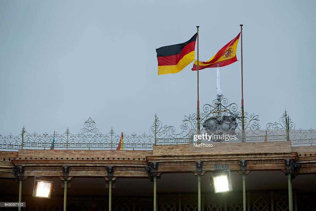 Spanish flag (R) and German flag wave during day two of the Davis Cup World Group Quarter Finals match between Spain and Germany at Plaza de Toros de Valencia on April 7, 2018 in Valencia, Spain