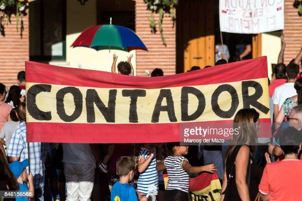 Spanish flag carried by fans during the tribute to the cyclist Alberto Contador in his hometown
