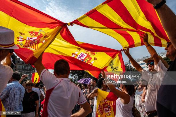 Spanish flag joined to another Catalan is seen at the act of the First Anniversary celebration Barcelona celebrated the first anniversary of the...
