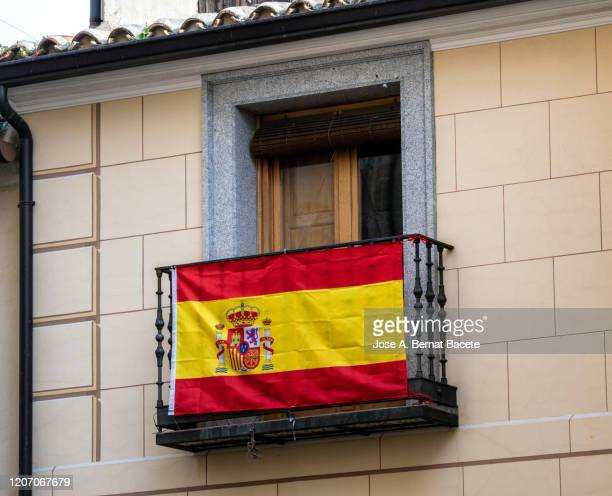spanish flag on a balcony. - spanish culture stock pictures, royalty-free photos & images