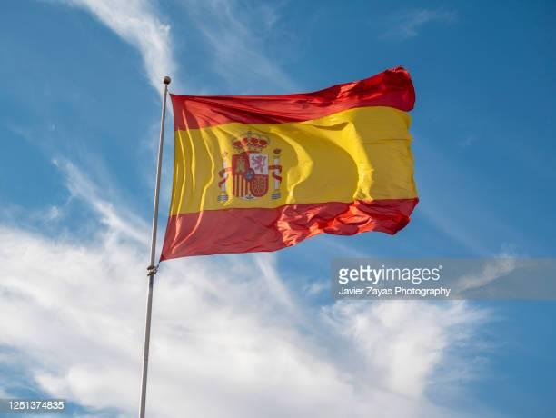 spanish flag waving - 旗棒 ストックフォトと画像