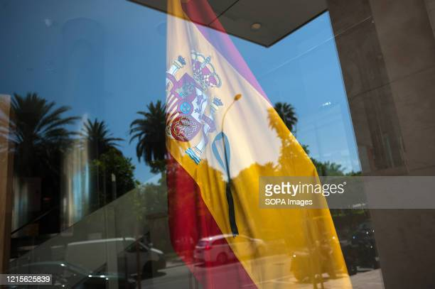 Spanish flag with a black ribbon is seen inside a hotel during the first day of national mourning in Spain declared by the Spanish government as...