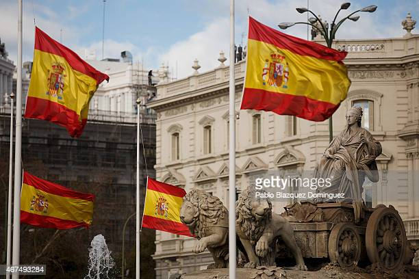 Spanish flags fly at halfmast in memory of the victims of the crash of an Airbus A320 airplane flying from Barcelona to Duesseldorf at Cibeles Square...