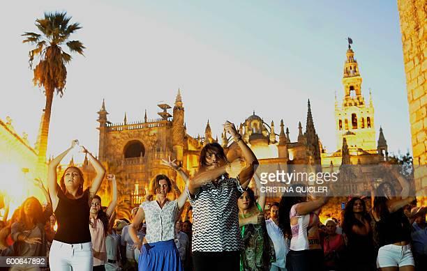 Spanish flamenco dancer Farruquito takes part in a flashmob as part of the Bienal de Flamenco in Sevilla at Plaza del Triunfo near the Cathedral on...