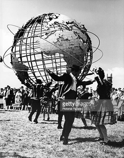 Spanish Flamenco dancers perform in front of the Unisphere steel globe at the World's Fair, Flushing Meadow, Queens, New York City, May 25, 1964.
