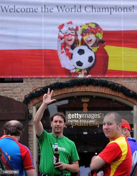 Spanish football fans react in front of the Hotel Gdansk on June 12 2012 in Gdansk Poland and Ukraine cohost the 2012 European Football Championship...