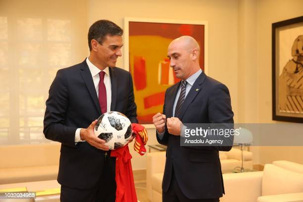 Spanish Football Federation Chairman Luis Rubiales gives a football ball to Prime Minister of Spain Pedro Sanchez as a present during their meeting...
