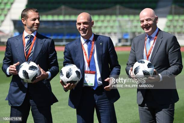 TOPSHOT Spanish Football Federation president Luis Rubiales poses with FIFA president Gianni Infantino and UEFA president Aleksander Ceferin along...