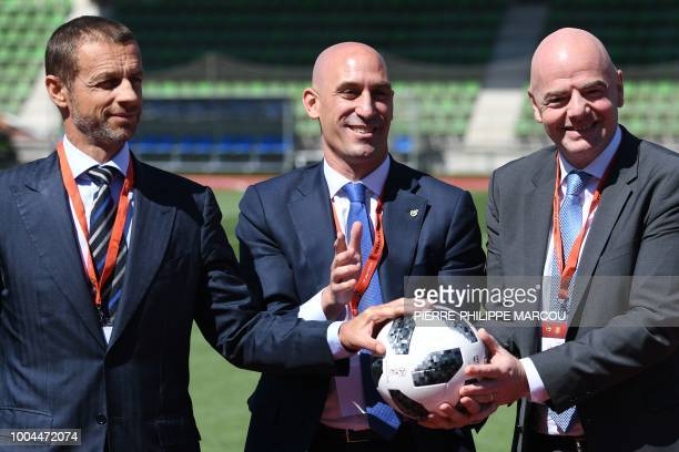 Spanish Football Federation president Luis Rubiales poses with FIFA president Gianni Infantino and UEFA president Aleksander Ceferin along with an...