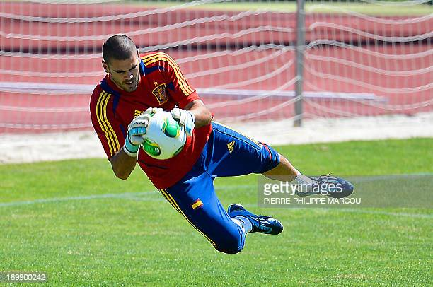 Spanish football goalkeeper Victor Valdes dives during a training session in Las Rozas on June 4 2013 The world champions begin their preparation for...