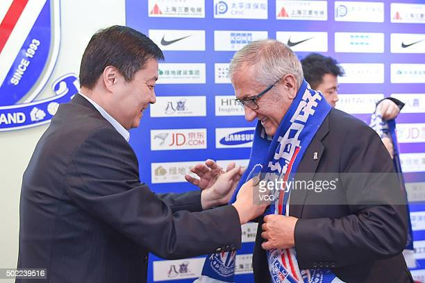 Spanish football manager Gregorio Manzano and Shenhua Chairman Wu Xiaobo attend the press conference of appointing Gregorio Manzano as the head coach...