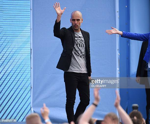Spanish football manager Pep Guardiola waves as he speaks to Manchester City fans as he is officially unveiled as the club's new manager at the City...