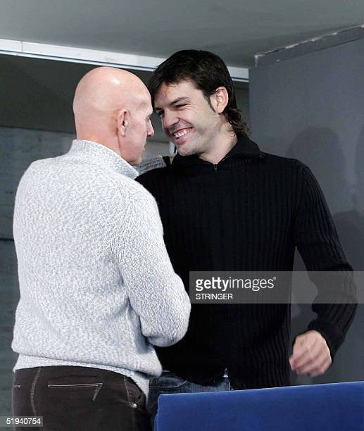 Spanish football player Fernando Morientes shakes hand with Real Madrid's director Italian Arrigo Sacchi after announcing during a news conference in...