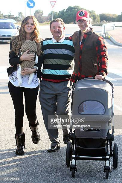 Spanish football player Jose Maria Gutierrez 'Guti' his girlfriend Romina Belluscio and their son Enzo are seen on February 20 2013 in Madrid Spain