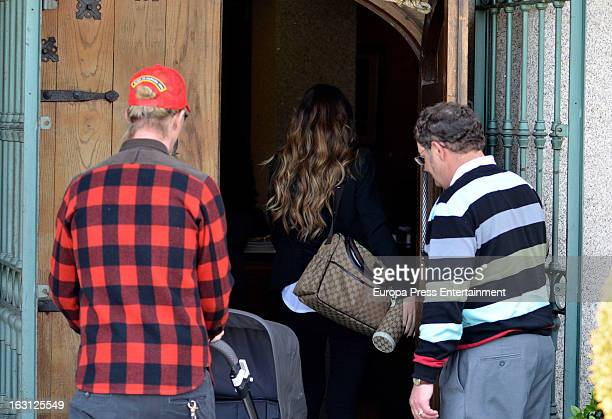 Spanish football player Jose Maria Gutierrez 'Guti' his girlfriend Romina Belluscio and their son Enzo are seen on February 20 2013 in Madrid Spain