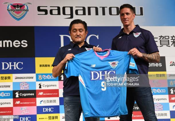 Spanish football star Fernando Torres and Sagan Dreams president Minoru Takehara pose during a press conference welcoming Torres to the JLeague club...