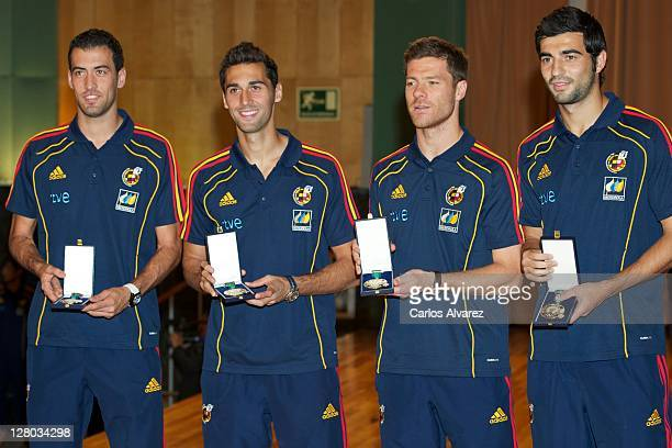 "Spanish football team players Sergio Busquets, Alvaro Arbeloa, Xabi Alonso and Raul Albiol pose for the photographers during ""Real Orden del Merito..."