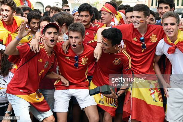 Spanish football team supporters shout and gesture at Catalunya square in Barcelona on June 27 2016 before the Euro 2016 football match between Spain...