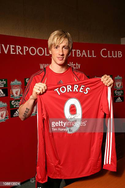 Spanish footballer Fernando Torres of Liverpool FC holding a signed number 9 shirt at the Club's Melwood training ground in West Derby Liverpool...