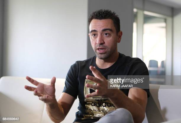 Spanish footballer Xavi Hernandez who currently plays for the Qatari football club AlSadd speaks to journalists during a tour of the Khalifa...