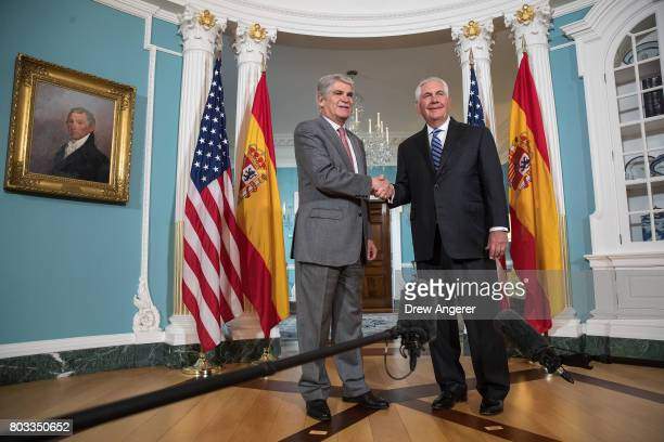 Spanish Foreign Minister Alfonso Dastis Quecedo shakes hands with US Secretary of State Rex Tillerson during a photo opportunity at the State...