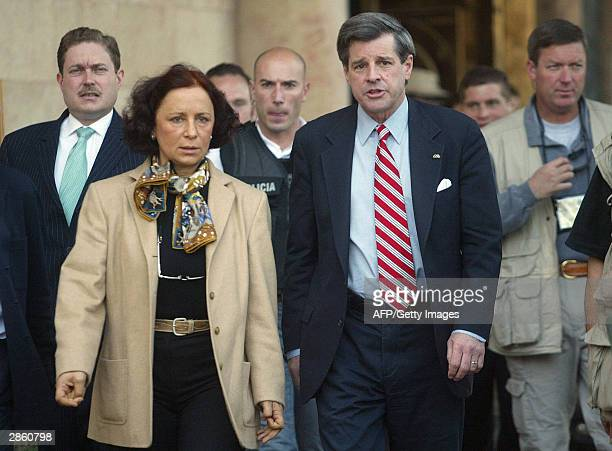 Spanish Foreign Minister Ana Palacio walks with top US administrator in Iraq Paul Bremer following talks in Baghdad 12 January 2004 focussing on the...