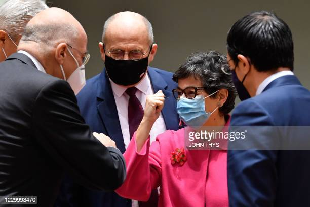 Spanish Foreign minister Arancha Gonzalez Laya greats counterparts at the start of the European Foreign Ministers Council on December 7, 2020 in...