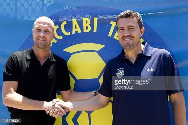 Spanish former footballer Oscar Garcia new manager coach of the Maccabi Tel Aviv football club shakes hands with team manager Jordi Cruyff before a...