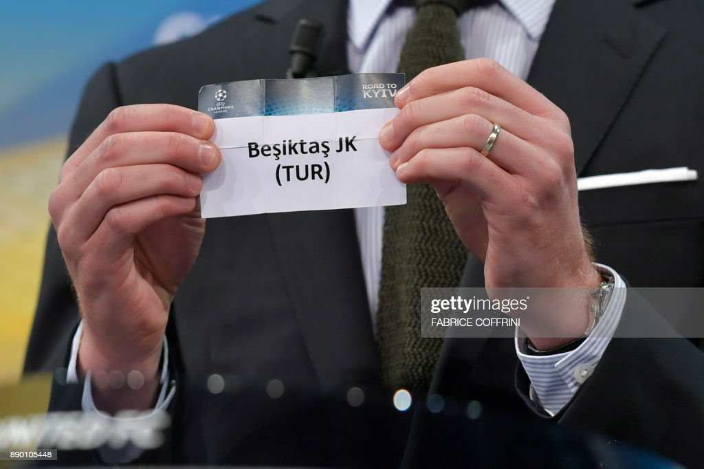 Spanish former international Xabi Alonso shows the slip of Besiktas JK during the draw for the round of 16 of the UEFA Champions League football tournament at the UEFA headquarters in Nyon on December 11, 2017. / AFP PHOTO / Fabrice COFFRINI