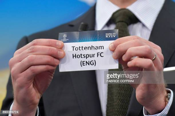 Spanish former international Xabi Alonso shows the slip of Tottenham Hotspur during the draw for the round of 16 of the UEFA Champions League...