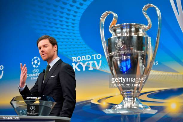 Spanish former international Xabi Alonso speaks next to the Champions League trophy ahead of the draw for the round of 16 of the UEFA Champions...