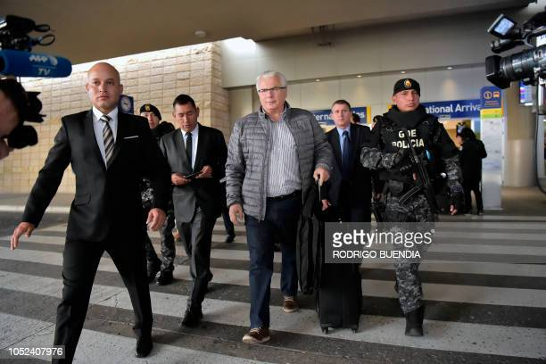 Spanish former judge Baltasar Garzon , lawyer of Wikileaks founder Julian Assange, is escorted after arriving at Mariscal Sucre international airport...