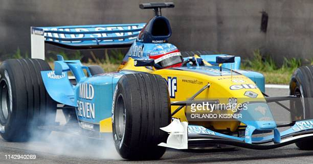Spanish Formula One driver Fernando Alonso blocks the front wheel of his Renault, 05 April 2003, during the free practices at Interlagos race track...