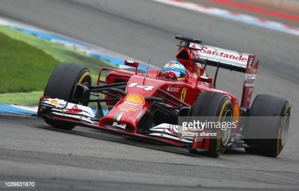 Spanish Formula One driver Fernando Alonso from team Ferrari steers his car during the GermanFormula One Grand Prix at the Hockenheimring race track...