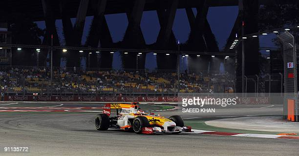 Spanish Formula One driver Fernando Alonso of Renault powers his car during a practice session for the Singapore Grand Prix on the Marina Bay City...