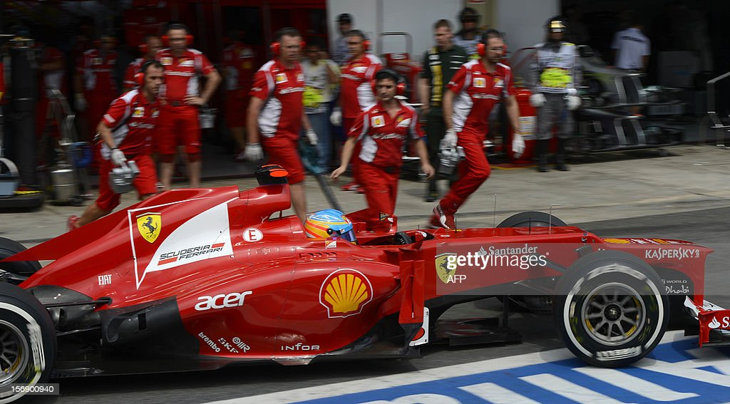 Spanish Formula One driver Fernando Alonso returns to the Ferrari pits during the qualifying session for the Brazilian GP on Sunday, during the qualifying at the Interlagos racetrack in Sao Paulo, Brazil on November 24 , 2012 .