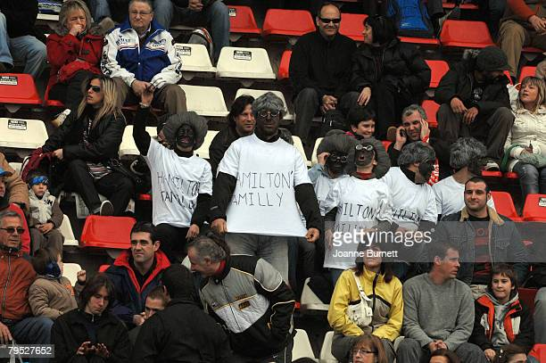 Spanish Formula One fans, wearing wigs and with blacked up faces, racially abuse Lewis Hamilton, during testing at the Curcuit de Catalunya, February...
