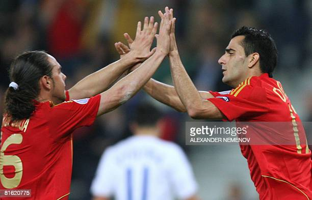 Spanish forward Daniel Guiza and Spanish forward Sergio Garcia celebrate a goal by teammate Ruben de La Red during the Euro 2008 Championships Group...