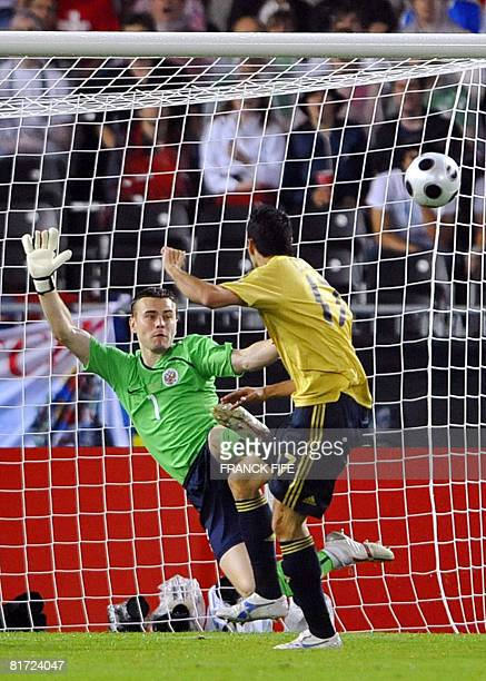 Spanish forward Daniel Guiza taps the ball past Russian goalkeeper Igor Akinfeev to score during the Euro 2008 championships semifinal football match...
