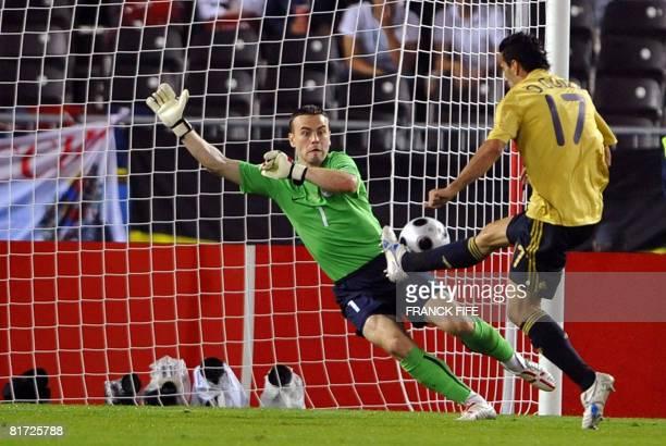 Spanish forward Daniel Guiza taps the ball past Russian goalkeeper Igor Akinfeev to score during the Euro 2008 championships semifinal football match...