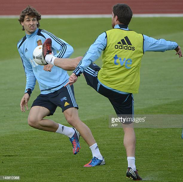 Spanish forward Fernando Llorente vies with Spanish midfielder Xabi during a training session in Gniewino on June 6 two days ahead of the Euro 2012...