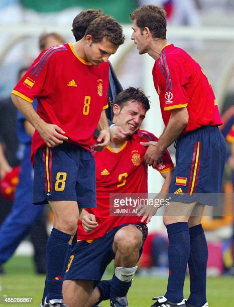 Spanish forward Fernando Morientes , midfielder Ruben Baraja and defender Romero react after their quarter-final match lost to South Korea at the...