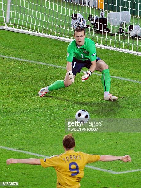 Spanish forward Fernando Torres attempts a goal opportunity in front of Russian goalkeeper Igor Akinfeev during the Euro 2008 championships semifinal...