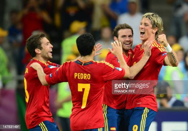 Spanish forward Fernando Torres is congratulated by teammates after scoring during the Euro 2012 football championships final match Spain vs Italy on...