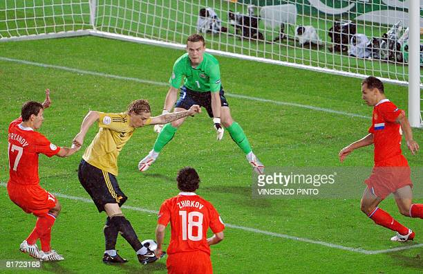 Spanish forward Fernando Torres kicks the ball in front Russian goalkeeper Igor Akinfeev during the Euro 2008 championships semifinal football match...