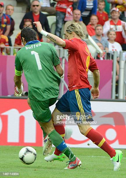 Spanish forward Fernando Torres vies Italian goalkeeper Gianluigi Buffon during the Euro 2012 championships football match Spain vs Italy on June 10...