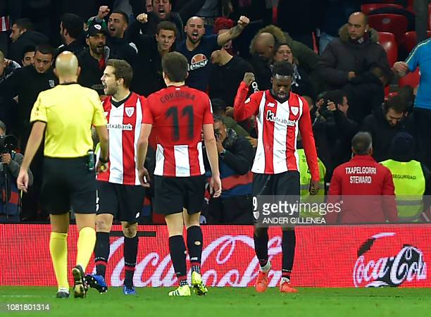 Spanish forward Inaki Williams celebrates after scoring his second goal during the Spanish League football match between Athletic Club Bilbao and...