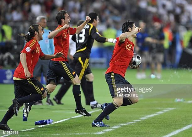 Spanish forward Sergio Garcia Spanish forward David Villa and Spanish defender Fernando Navarro celebrate at the end of the Euro 2008 championships...