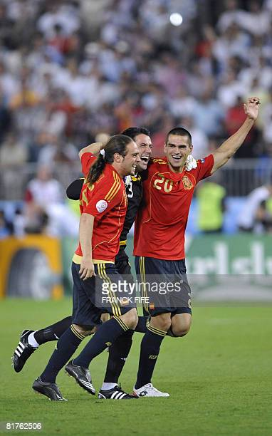 Spanish forward Sergio Garcia Spanish goalkeeper Andres Palop and Spanish defender Juanito celebrate after the Euro 2008 championships final football...
