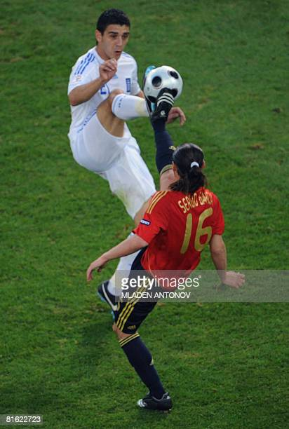 Spanish forward Sergio Garcia vies for the ball with Greek midfielder Kostas Katsouranis during the Euro 2008 Championships Group D football match...